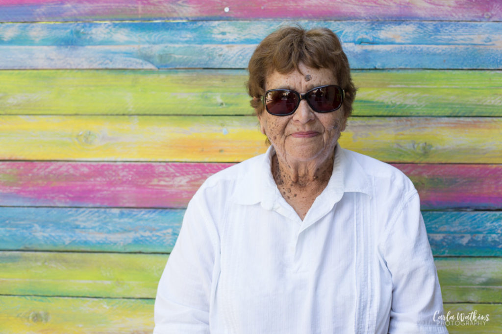 Gran in her sunglasses on a rainbow background | Carla Watkins Photography | carlawatkinsphotography.com