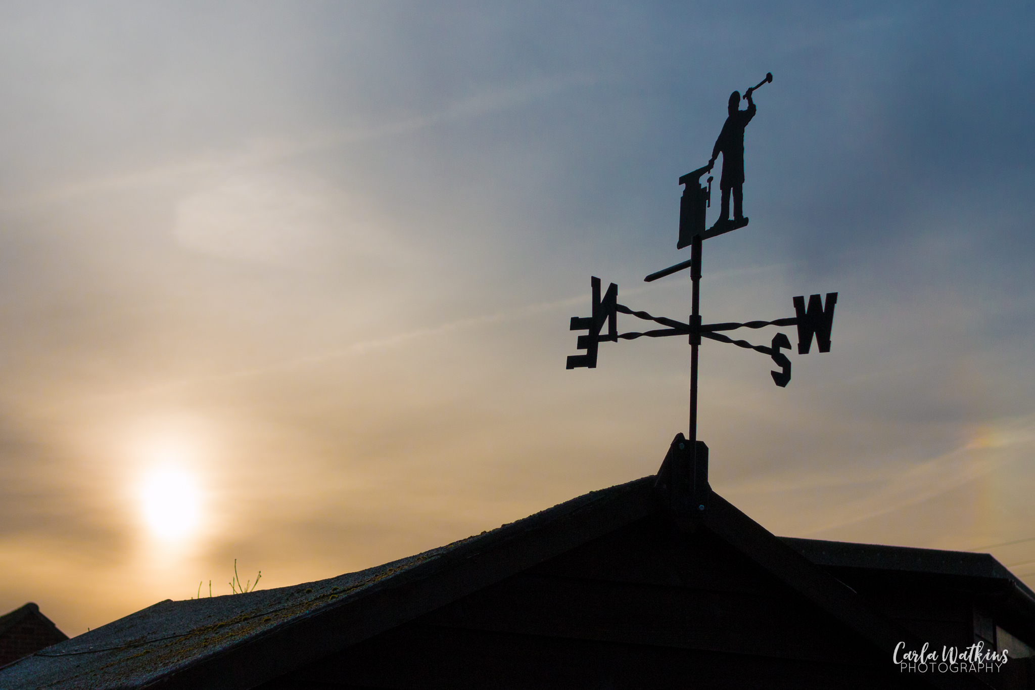 weathervane with a blacksmith, facing a rising sun | Carla Watkins Photography 2016 | carlawatkinsphotography.com